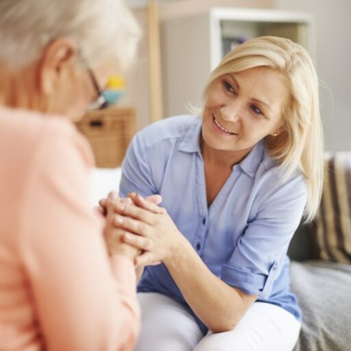 An adult woman talks to her senior monther, as they consider planning for the future.