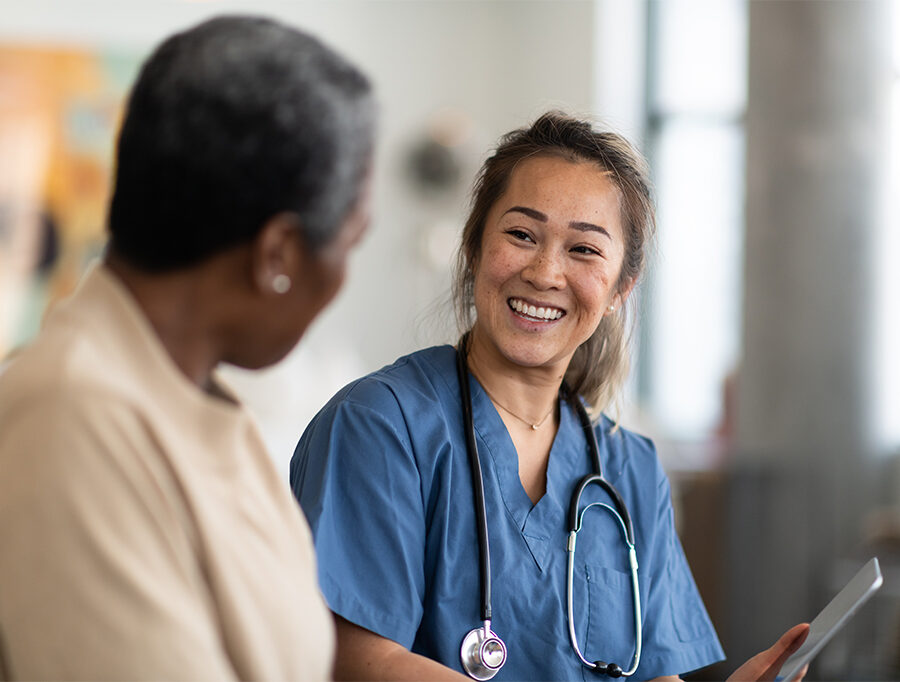 Young female nurse and older woman discussing senior living options