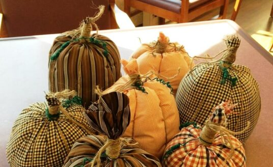 Making fabric pumpkins like these can be a fun and easy Halloween craft for seniors.