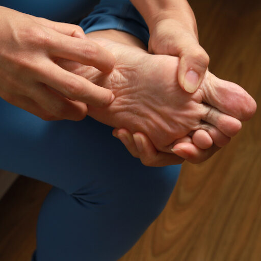 Person holds their foot which is in pain due to poor foot health